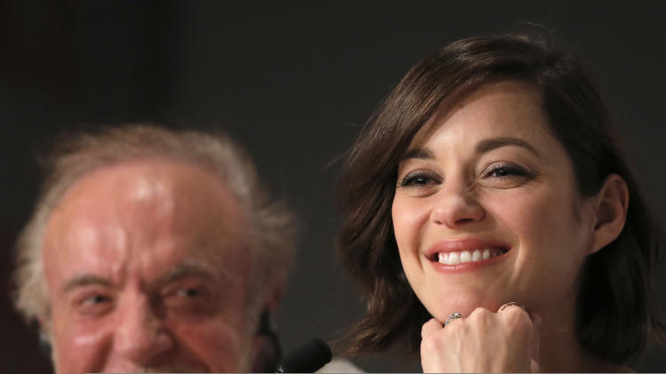 Actors Marion Cotillard, right, and James Caan listen to questions during the press conference of Blood Ties at the 66th international film festival, in Cannes, southern France, Monday, May 20, 2013. (AP Photo/Francois Mori)