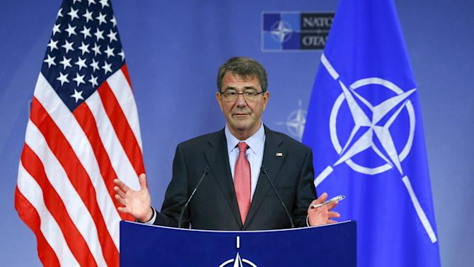 U.S. Secretary of Defense Ash Carter speaks at a news conference during a NATO Defence Ministers meeting at the Alliance's headquarters in Brussels