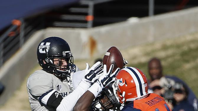 Utah State's Tyler Floyd (15) intercepts a pass intended for UTEP's Ian Hamilton (14) as Utah State's Brian Suite, left, moves in to help out during the second half of the New Mexico Bowl NCAA college football game Saturday, Dec. 20, 2014, in Albuquerque, N.M. Utah State defeated UTEP 21-6. (AP Photo/Ross D. Franklin)