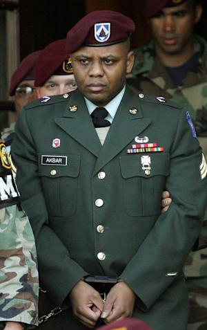 FILE - In this Monday, April 25, 2005, file photo, Sgt. Hasan Akbar is led from the Staff Judge Advocate Building at Fort Bragg, N.C., during the sentencing phase of his court-martial. Akbar, who was sentenced to death for killing two fellow service members and wounding 14 others in a grenade attack in Kuwait, will have an appeal in military court, on Nov. 18, in Washington. (AP Photo/Gerry Broome, File)
