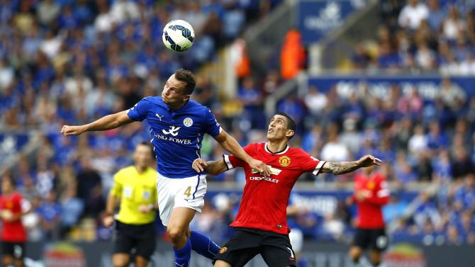 Manchester United's Di Maria challenges Leicester City's Drinkwater during their English Premier League soccer match at the King Power stadium in Leicester