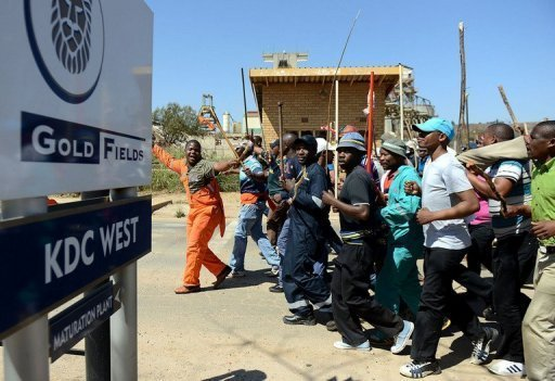 <p>Striking Gold Fields mine workers march in Carletonville, west of Johannesburg, in September 2012. South African miner Gold Fields on Tuesday fired 8,500 workers who refused to halt an illegal stoppage at its KDC East mine, a spokesman said.</p>