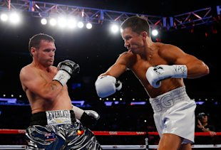Gennady Golovkin fires a right at Daniel Geale during their WBA middleweight championship bout at Madison Square Garden Saturday in New York. (Photo b...