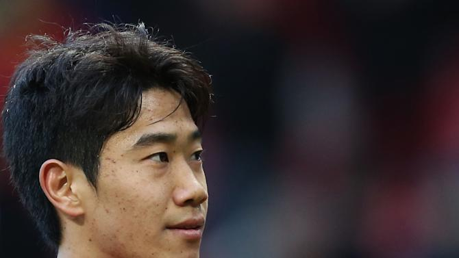 Manchester United's Shinji Kagawa who scored a hat trick applauds supporters after his team's 4-0 win over Norwich during their English Premier League soccer match at Old Trafford Stadium, Manchester, England, Saturday March 2, 2013. (AP Photo/Jon Super)