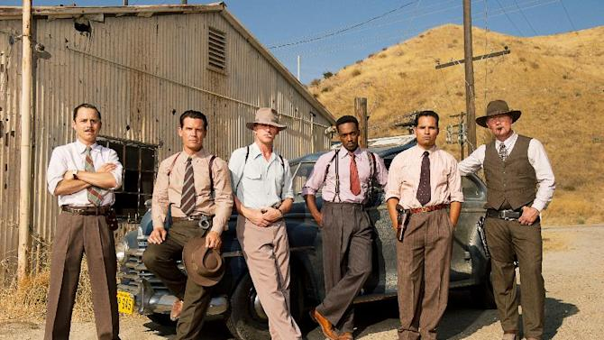 "This film image released by Warner Bros. Pictures shows, from left, Giovanni Ribisi as Officer Conwell Keeler, Josh Brolin, as Sgt. John O'Mara, Ryan Gosling as Sgt. Jerry Wooters, Anthony Mackie as Officer Coleman Harris, Michael Pena as Officer Navidad Ramirez and Robert Patrick as Officer Max Kennard in ""Gangster Squad."" (AP Photo/Warner Bros. Pictures, Wilson Webb)"