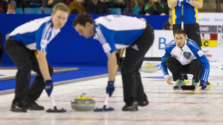 Team British Columbia skip John Morris yells instructions in the 2nd end against team Alberta during their draw at the 2014 Tim Hortons Brier curling championships in Kamloops