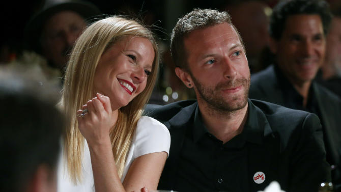 """FILE - This Jan. 11, 2014 file photo shows actress Gwyneth Paltrow, left, and her husband, singer Chris Martin at the 3rd Annual Sean Penn & Friends Help Haiti Home Gala in Beverly Hills, Calif. Paltrow and Martin are separating after 11 years of marriage. A message posed on the 41-year-old actress' blog Tuesday, March 25, says that the couple has """"come to the conclusion that while we love each other very much we will remain separate."""" Paltrow and the 37-year-old musician married in 2003. The couple has two children, 9-year-old daughter Apple and 7-year-old son Moses. (Photo by Colin Young-Wolff /Invision/AP, File)"""
