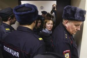 """Zaspa, the""""Arctic Sunrise"""" ship's doctor, who was arrested over a Greenpeace protest at the Prirazlomnaya oil rig, is escorted before a court session in St. Petersburg"""