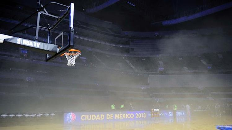 General view inside the Arena Ciudad de Mexico where players were evacuated from smoke before the NBA match between Minnesota Timberwolves and San Antonio Spurs in Mexico City on December 4, 2013