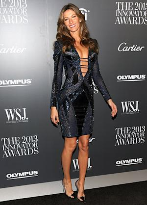 Gisele Bundchen Shows Off Cleavage, Long Legs in Atelier Versace Dress