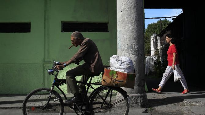 A man rides his bicycle in Havana
