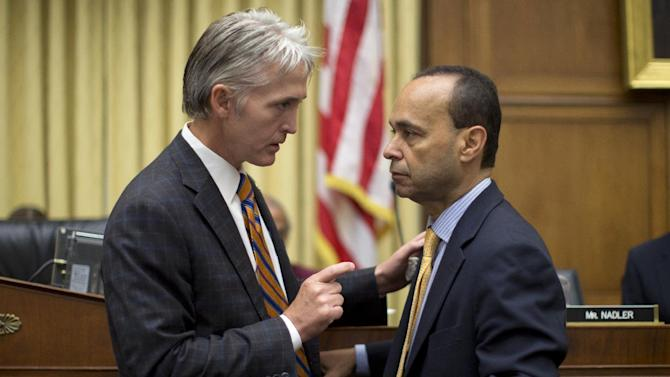 House Judiciary Committee member Rep. Trey Gowdy, R-S.C., sponsor of the Strengthen and Fortify Enforcement Act, left, talks with Rep. Luis Gutierrez, D-Ill., on Capitol Hill in Washington, Tuesday, June 18, 2013, prior to the start of the committee's hearing to discuss the Strengthen and Fortify Enforcement Act. The committee in the Republican-led House is preparing to cast its first votes on immigration this year, on a tough enforcement-focused measure that Democrats and immigrant groups are protesting loudly. (AP Photo/Carolyn Kaster)