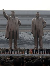North Korean leader Kim Jong-Un (C) attends the unveiling ceremony of statues of former leaders Kim Il-Sung and Kim Jong-Il in Pyongyang