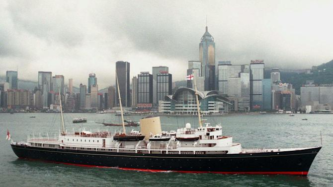 FILE - A June 23, 1997 photo from files showing the Royal Yacht Britannia passing the new Hong Kong Convention Center in Hong Kong Harbor. What do you get for a monarch who has almost everything? Not, apparently, a new yacht, at least not one paid for with taxpayer funds. That was the message Monday, Jan. 16, 2012,  as a brief boomlet of support for the idea of providing Queen Elizabeth II with a new royal yacht to mark her Diamond Jubilee was quickly deflated by Prime Minister David Cameron. It is estimated that a new yacht would cost at least 60 million pounds ($92 million/72,455,000 euro). Cameron's spokesman Steve Field said it would not be appropriate for public funds to be spent on a new yacht during times of economic hardship. (AP Photo/Pool, File)