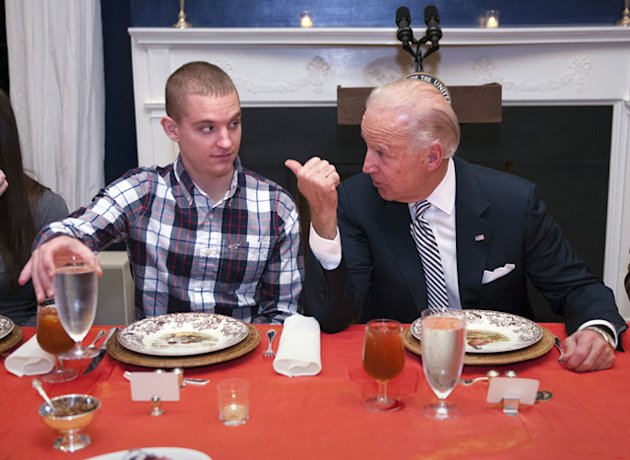 Joe Biden talks with Marine Lance Cpl. Nathan Jakubisin. (AP/Cliff Owen)