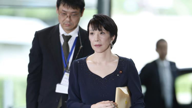 Japan's new Internal Affairs and Communications Minister Takaichi arrives at Prime Minister Shinzo Abe's official residence in Tokyo