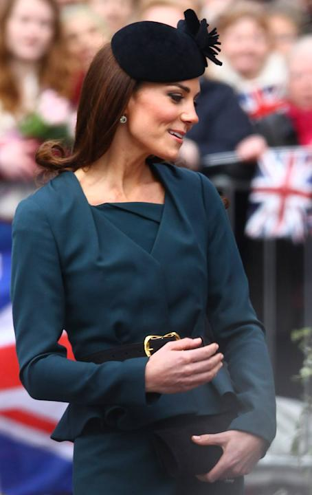Here's Kate on the first day of the Diamond Jubilee tour on March 8. She wears dark green tailored peplum jacket and matching jacket from British high street brand LK Bennett. She pairs the outfit wit