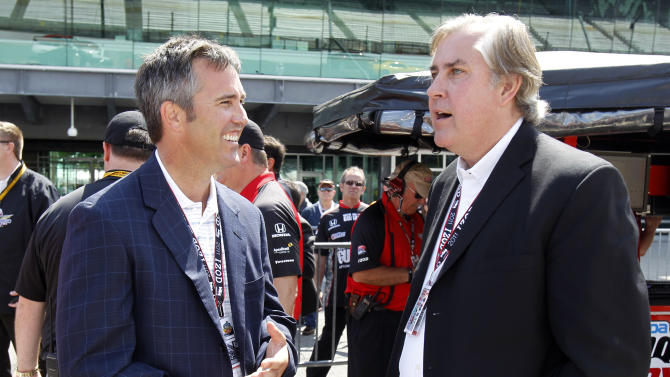 FILE - In this May 14, 2011, file photo, Jeff Belskus, right, and Randy Bernard talk before practice for the Indianapolis 500 auto race at Indianapolis Motor Speedway in Indianapolis. It's business as usual for the IndyCar Series, which is staying the course set by former CEO Bernard. Only the series will be led for now by Belskus, head of Indianapolis Motor Speedway. Belskus reiterated Thursday, Nov. 1, 2012, that IndyCar is not for sale and the Hulman-George family believes in the future of the series. Belskus spoke at length for the first time since Bernard's three-year run came to an end following Sunday night's emergency meeting of the IMS board of directors. It was called after a frenzied month of speculation about Bernard's future. (AP Photo/Darron Cummings, File)
