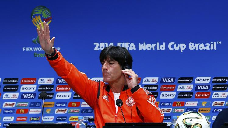 Germany's coach Loew gestures during a news conference at the Maracana stadium in Rio de Janeiro