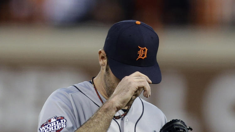 Detroit Tigers' Justin Verlander reacts after San Francisco Giants' Pablo Sandoval hit a two-run home run during the third inning of Game 1 of baseball's World Series Wednesday, Oct. 24, 2012, in San Francisco. (AP Photo/Marcio Jose Sanchez)
