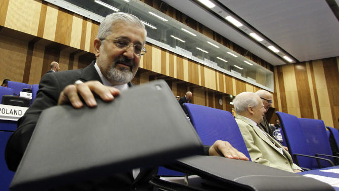 Iran's Ambassador to the International Atomic Energy Agency, IAEA, Ali Asghar Soltanieh gets ready for the IAEA board of governors meeting at the International Center, in Vienna, Austria, on Monday, June 4, 2012. (AP Photo/Ronald Zak)