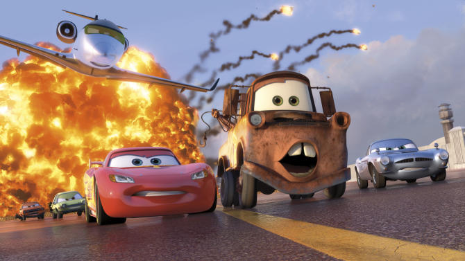 "FILE - In this file film publicity image released by Disney-Pixar, animated characters Lightning McQueen, voiced by Owen Wilson, foreground left, Mater, voiced by Larry the Cable Guy, center, and Finn McMissile, voiced by Michael Caine, right, are shown in a scene from ""Cars 2."" ""Cars 2"" went out this summer in 44 different languages. And every country faced the same problem when it came to dubbing the aw-shucks ramblings of one of the movie's lead characters _ the country bumpkin tow truck Mater, voiced in the movie by Larry the Cable Guy.   (AP Photo/Disney/Pixar, File)"
