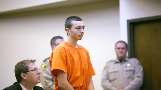 Kirk Levin, 21, makes his initial appearance with defense attorney Chuck Kenville in Sac City, Iowa, on Tuesday, Jan. 8, 2013. Levin was charged with first-degree murder for allegedly killing his mother, Marilyn Schmitt, 45, last week in her rural Early, Iowa, home. (AP Photo/Carroll Daily Times Herald, Jared Strong)