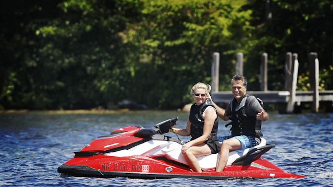 Republican presidential candidate, former Massachusetts Gov. Mitt Romney and wife Ann Romney ride a jet ski on Lake Winnipesaukee in Wolfeboro, N.H., Monday, July 2, 2012, where Romney has a vacation home. (AP Photo/Charles Dharapak)