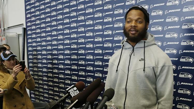 Seattle Seahawks defensive end Michael Bennett talks to reporters Monday, March 10, 2014, at the team's headquarters in Renton, Wash. The Seahawks announced Monday that Bennett, who was one of the top NFL football free agents this year, had signed a multi-year deal with the Super Bowl champion Seahawks