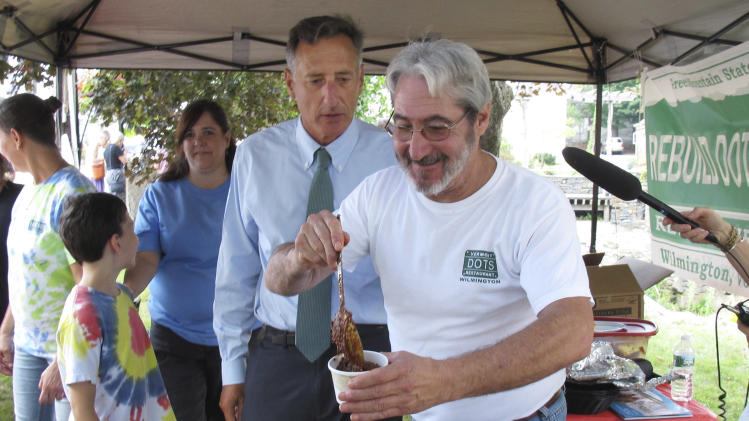 Dot's Diner dinner chef Mitch Soskin serves Vermont Gov. Peter Shumlin, center, a bowl of chili Wednesday Aug. 28, 2013 in Wilmington, Vt. Shumlin was in Wilmington to commemorate the second anniversary of Tropical Storm Irene. Shumlin held up Dot's as an example of how far the state has come and how much is left to do. Dot's is expected to reopen this fall. (AP Photo/Wilson Ring)