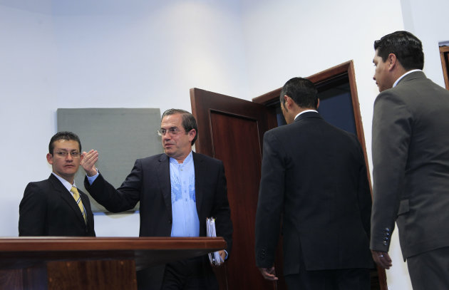 Ecuador's Foreign Minister Ricardo Patino, second from left, gestures after giving a news conference where he announced that Ecuador would grant asylum to WikiLeaks' founder Julian Assange, in Quito, Ecuador, Thursday, Aug. 16, 2012. The announcement comes two months after Assange took refuge in its London embassy to avoid extradition to Sweden to face questioning for alleged sexual misconduct. (AP Photo/Dolores Ochoa)