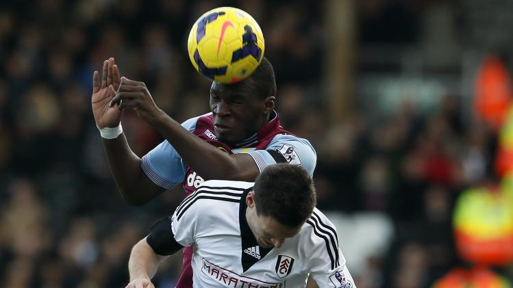 Fulham's Riether challenges Aston Villa's Benteke during their English Premier League soccer match in London