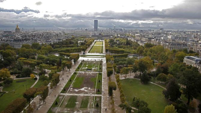 An aerial view shows the Champs de Mars, the Invalides, the Tour Montparnasse and the Paris skyline
