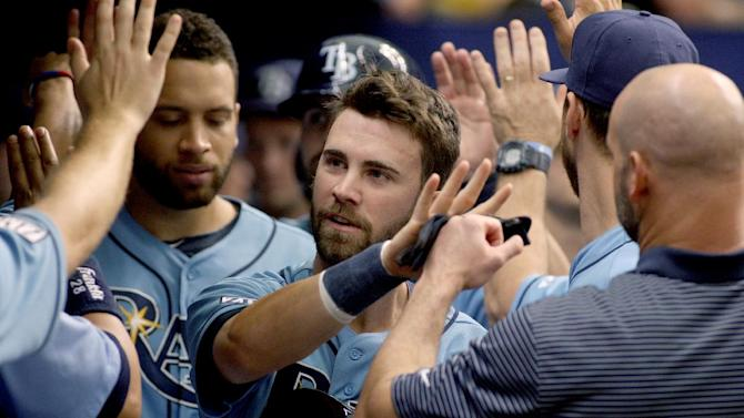 Tampa Bay Rays catcher Curt Casali (59) gets high-fives in the dugout after scoring on Brandon Guyer's single during the ninth inning of a baseball game against the Chicago White Sox on Sunday, Sept. 21, 2014 in St. Petersburg, Fla. The Chicago White Sox won 10-5. (AP Photo/Reinhold Matay)