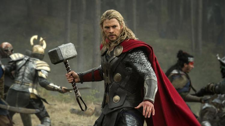 "FILE - This publicity file photo released by Walt Disney Studios and Marvel shows Chris Hemsworth in a scene from ""Thor: The Dark World."" ""Thor: The Dark World"" continued its box-office reign with $38.5 million in its second week, holding off ""The Best Man Holiday,"" according to studio estimates Sunday, Nov. 17, 2013. (AP Photo/Walt Disney Studios/Marvel, Jay Maidment, File)"