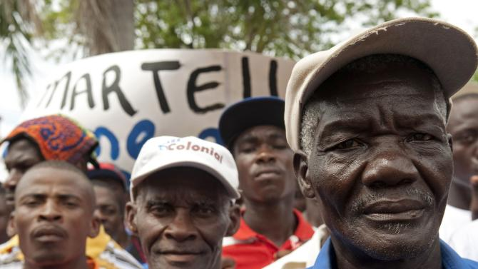 Haitian citizens who work on sugar cane plantations in the Dominican Republic march towards their embassy  in Santo Domingo