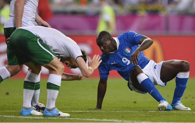 Italian Forward Mario Balotelli (R) Stands AFP/Getty Images