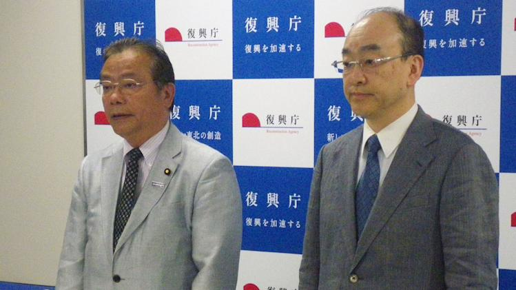In this Thursday, June 13, 2013 photo, Reconstruction Vice Minister Koichi Tani, left, and the ministry director-general Masakatsu Okamoto stand at a press conference as they apologize on the ministry's senior official in charge of helping victims of the Fukushima Dai-ichi nuclear crisis Yasuhiro Mizuno, not shown,  at the ministry in Tokyo. These are perilous times for Japanese politicians who are increasingly using social media to voice their opinions and rally support  - sometimes with awkward or potentially costly repercussions. In the latest flap over opinions shared or reported over social media, Mizuno was dismissed last week after he used a vulgarity to deride civil activists.  (AP Photo/Kyodo News) JAPAN OUT, CREDIT MANDATORY