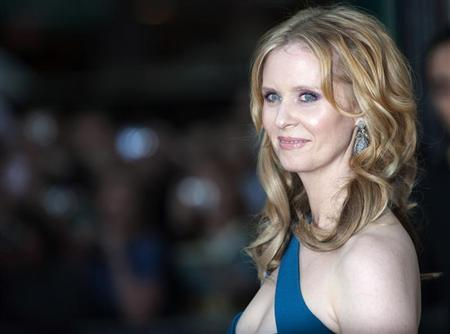 "Actress Cynthia Nixon poses for photographers at the premiere of ""Sex and the City 2"" in London"