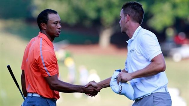 Tiger Woods (L) shakes hands with Henrik Stenson of Sweden following the first round of the Tour Championship at East Lake Golf Club (AFP)
