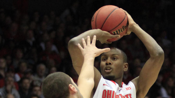 Ohio State forward Sam Thompson (12) shoots over Iowa State forward Georges Niang in the first half of a third-round game of the NCAA college basketball tournament Sunday  March 24, 2013, in Dayton, Ohio.  (AP Photo/Skip Peterson)