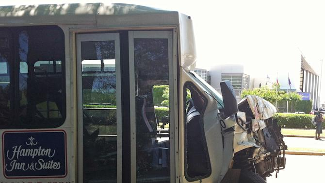 A wrecked airport shuttle bus is shown  Friday, May 24, 2013 in College Park, Ga. The bus collided with a truck near Hartsfield Jackson Atlanta International Airport injuring 16 people who were taken to area hospitals. (AP Photo/Ray Henry)