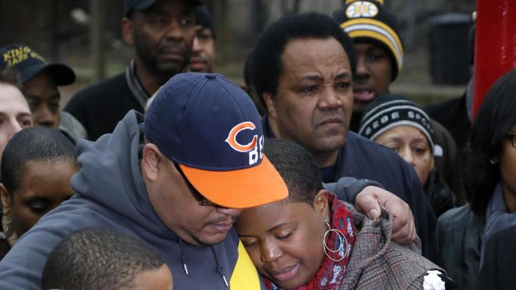 Nathaniel Pendleton, center, hugs his son Nathaniel Jr. and his wife Cleopatra during a news conference with Chicago Police Superintendent Garry McCarthy seeking help from the public in solving the murder of Pendleton's daughter Hadiya Wednesday, Jan. 30, 2013, in Chicago.  Hadiya, 15, who had performed in President Barack Obama's inauguration festivities, was killed in a Chicago park as she talked with friends by a gunman who apparently was not even aiming at her. The city's 42nd slaying is part of Chicago's bloodiest January in more than a decade, following on the heels of 2012, which ended with more than 500 homicides for the first time since 2008. It also comes at a time when Obama, spurred by the Connecticut elementary school massacre in December, is actively pushing for tougher gun laws. (AP Photo/Charles Rex Arbogast)