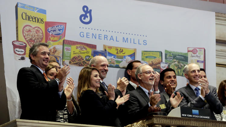 FILE - In this July 8, 2014 file photo, General Mills Chairman & CEO Kendall Powell, second from right, joins in applause as he rings the New York Stock Exchange Tuesday opening bell, July 8, 2014. The Minneapolis-based company, which last month announced a cost-cutting plan that will include a review of its manufacturing plants, is working to adapt its offerings as it grapples with the changing eating habits of Americans. (AP Photo/Richard Drew, File)