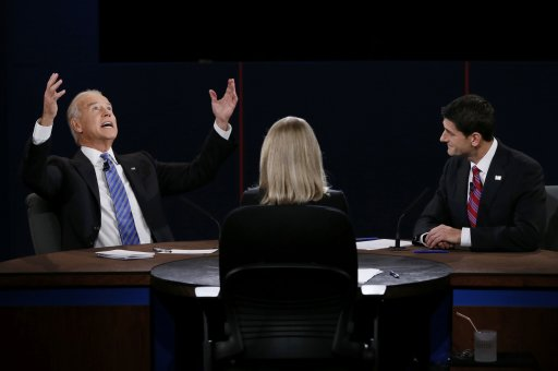 U.S. Vice President Biden makes a point in front of Republican vice presidential nominee Ryan and moderator Raddatz during the vice presidential debate in Danville