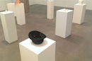 Yoko Ono channels Simpsons by exhibiting a single plum, floating in perfume, served in a man's hat
