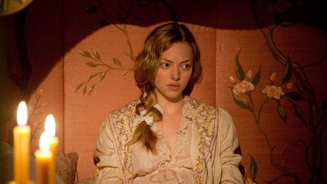 "This film image released by Universal Pictures shows Amanda Seyfried as Cosette in a scene from ""Les Miserables."" (AP Photo/Universal Pictures, Laurie Sparham)"