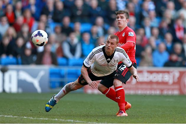 Fulham's Steve Sidwell, left, heads the ball to score but is disallowed for offside during the English Premier League soccer match between Cardiff and Fulham at Cardiff City Stadium, Cardiff, Wale