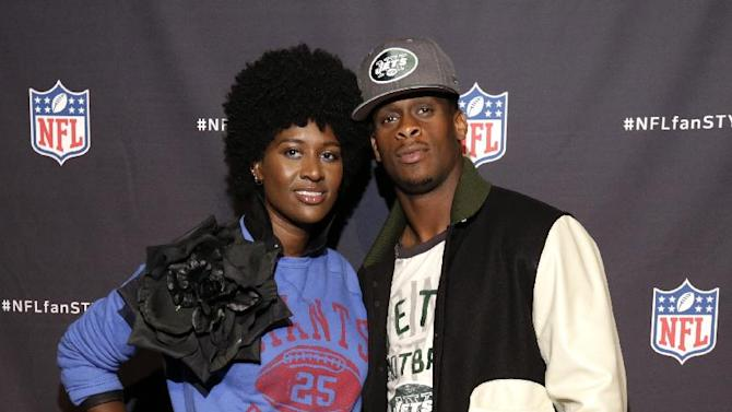 IMAGE DISTRIBUTED FOR NATIONAL FOOTBALL LEAGUE -  Style strategist Rachel Johnson and New York Jets quarterback Geno Smith walk the red carpet at the NFL Hall of Fashion at Pillars 37 in New York on Sept. 16, 2014. (Ed Rieker/AP Images for National Football League)
