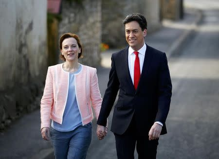 Britain's opposition Labour Party leader Ed Miliband arrives to vote with his wife Justine in Doncaster, northern England